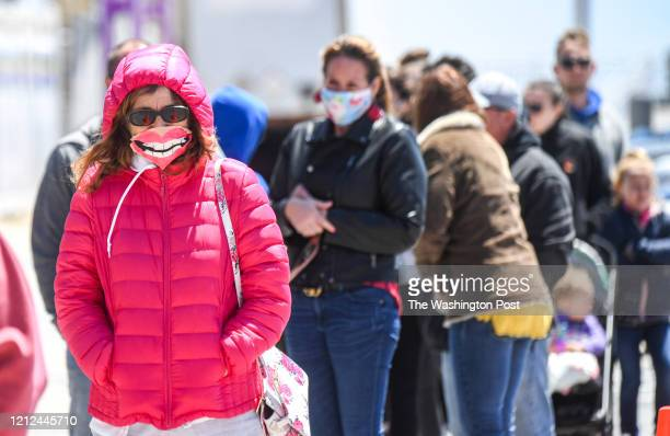 Ocean City resident Rita Miller was all smiles as she waited in line for Thrasher's French Fries on the boardwalk in Ocean City as Maryland Governor...