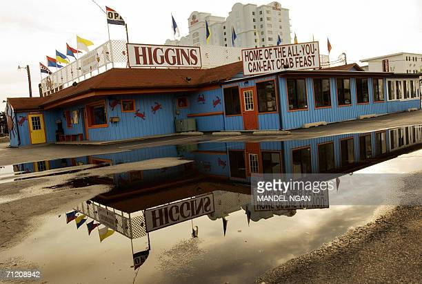 Ocean City, UNITED STATES: An image of a restaurant is reflected in a puddle in Ocean City, Maryland 08 June 2006. Many hotels and restaurants in the...