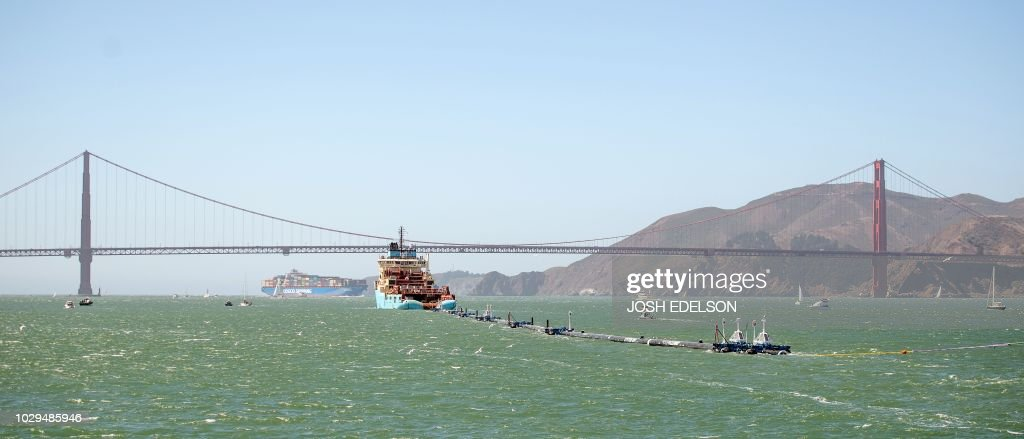 Ocean Cleanup's System 001 is towed out of the San Francisco Bay in San Francisco, California on September 08, 2018. - The prototype technology, developed by Boyan Slat, is about 2,000 feet of floating booms that will be towed out to the Great Pacific Garbage Patch, a floating mass of plastics and trash about the size of France, in hopes of helping remove the pollutants.