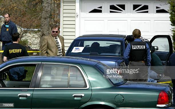 Ocean County NJ sheriff's officers investigate the scene of Seaside Heights NJ police officer Edward Lutes dead in his car April 10 2002 in Barnegat...
