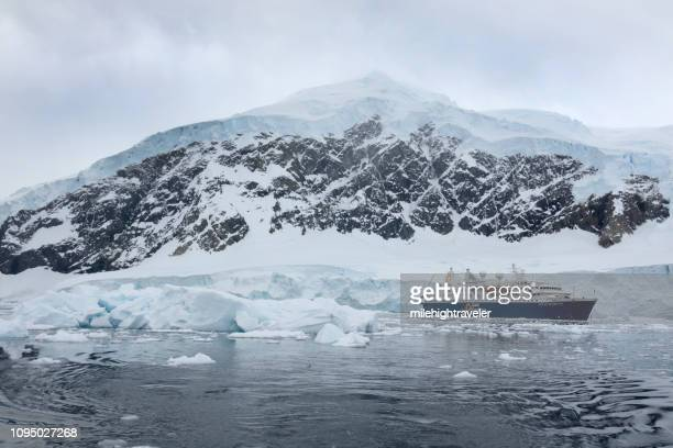 Ocean Diamond ship cruises ice filled Neko Harbor Antarctic Peninsula mountain glaciers Antarctica