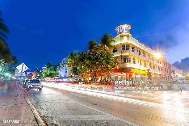 Ocean drive art deco scene with lights on, Miami.