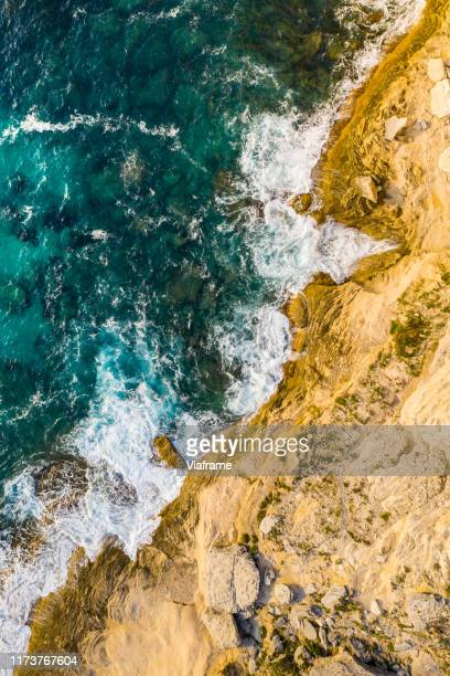 colorfull drone shot coast with waves