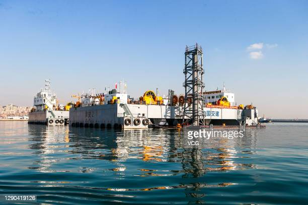 Ocean engineering vessels Jin An 2 and Jin An 3 are seen as the first immersed tubes of Dalian Bay Undersea Tunnel is ready to be installed on...
