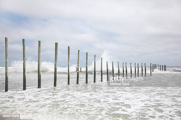 ocean fence at the virginia north carolina line - north carolina us state stock pictures, royalty-free photos & images