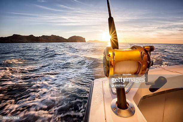 ocean fishing reel on a boat in the ocean - big game fishing stock photos and pictures