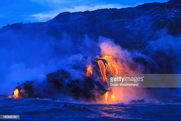 ocean front lava - active volcano stock pictures, royalty-free photos & images