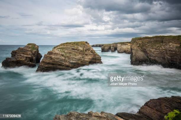 ocean in the north west of spain, galicia region with dramatic clouds and moving water - comunidad autónoma de galicia fotografías e imágenes de stock