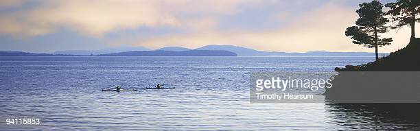 ocean kayakers with islands in background - timothy hearsum stock photos and pictures