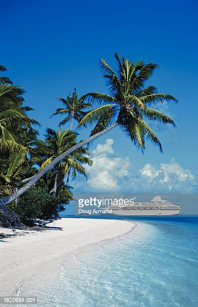 ocean liner off shores of tropical island, cook islands (composite) - oceania stock pictures, royalty-free photos & images