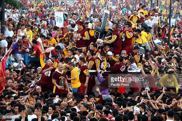 Ocean of devotees flooded in Rizal Park in Manila to joined the Traslacion of the Black Nazarene Festival Devotees trying to touch the icon of Black...