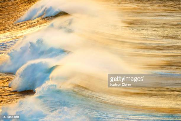 ocean shot with breaking waves and early morning light