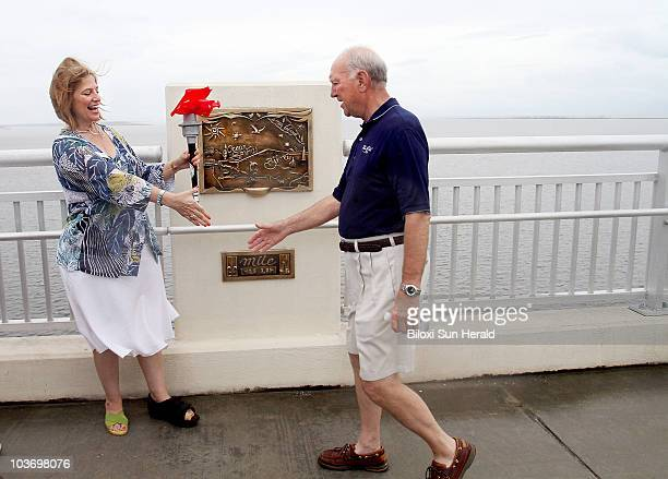 Ocean Springs Mayor Connie Moran left meets Biloxi Mayor AJ Holloway at the apex of the Biloxi Bay Bridge in Mississippi on the last leg of the Bacot...