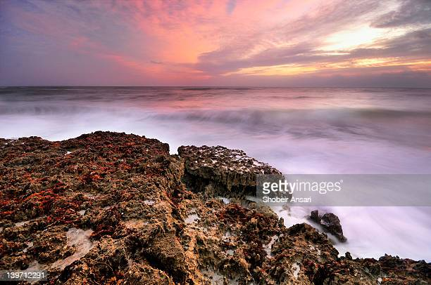 Ocean sunrise and craggy limestone Rocks