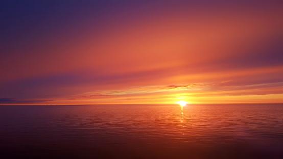 Ocean sunset 1075459908