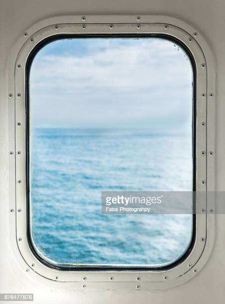 ocean through porthole - porthole stock photos and pictures