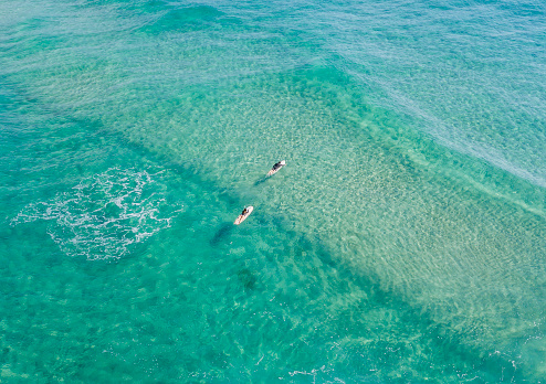 Ocean waters with surfers seen from above - gettyimageskorea
