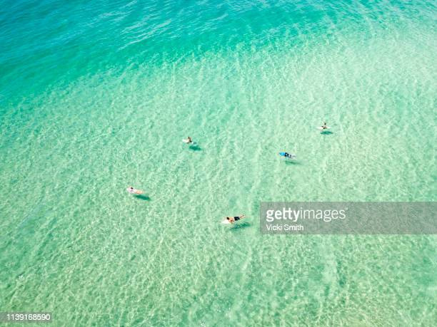 ocean waters with surfers seen from above - 清らか ストックフォトと画像