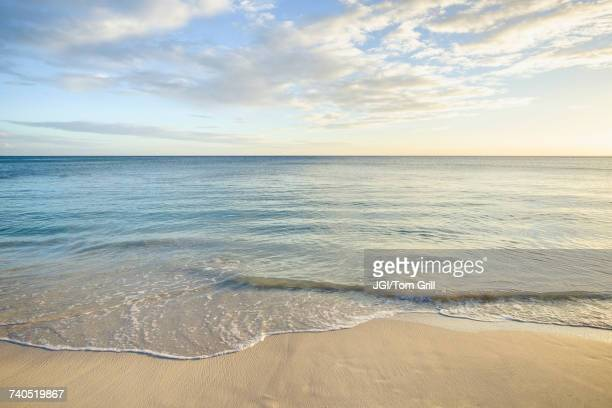 ocean wave on beach - horizon over water stock pictures, royalty-free photos & images