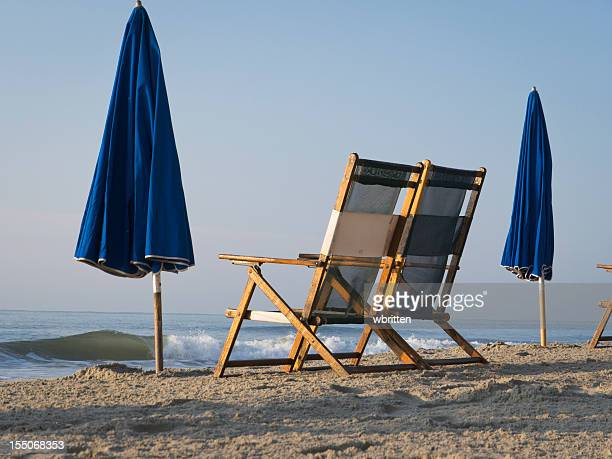 Ocean waves and beach chairs in a vacation scene