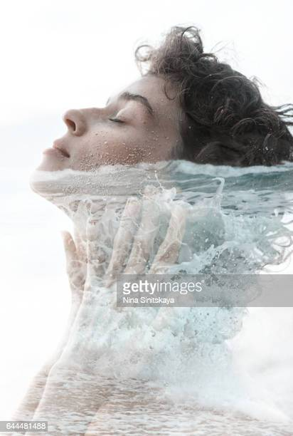 Ocean waves and woman's body - double exposure image