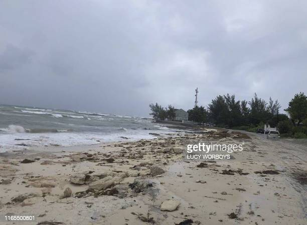 Ocean waves are seen on the beach during the approach of Hurricane Dorian on September 1 2019 in Nassau Bahamas Hurricane Dorian strengthened into a...