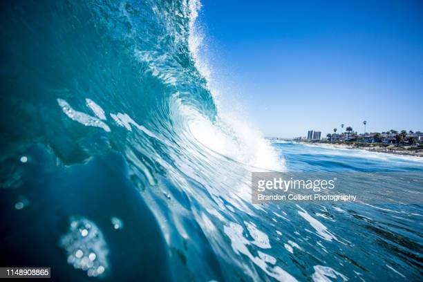 ocean waves - teal stock pictures, royalty-free photos & images