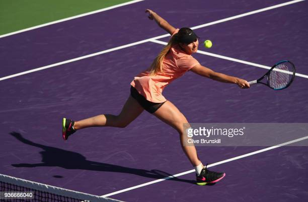 Oceane Dodin of France plays a backhand volley against Simona Halep of Romania in their second round match during the Miami Open Presented by Itau at...