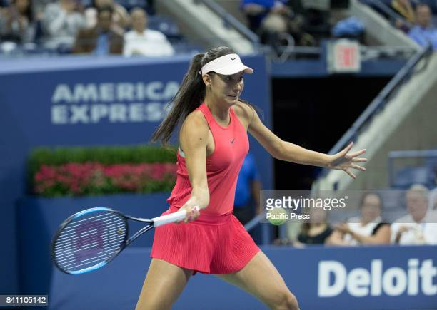 Oceane Dodin of France returns ball during match against Venus Williams of USA at US Open Championships at Billie Jean King National Tennis Center