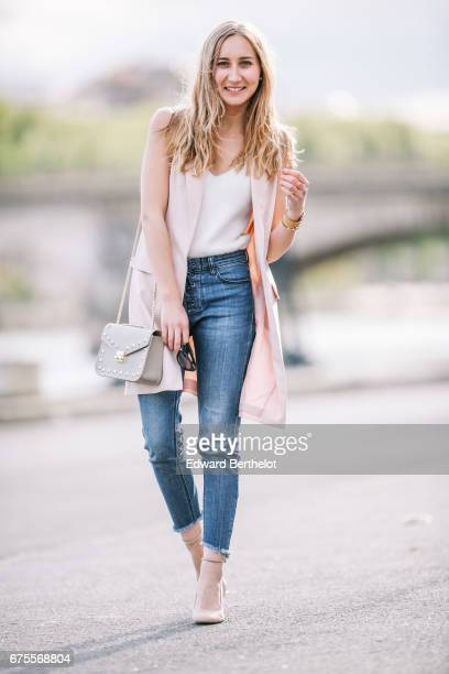 Oceane Grilhe fashion blogger The Blondie World wears a Bershka white low neck top Bershka blue denim jeans a New Look pink sleeveless jacket and New...