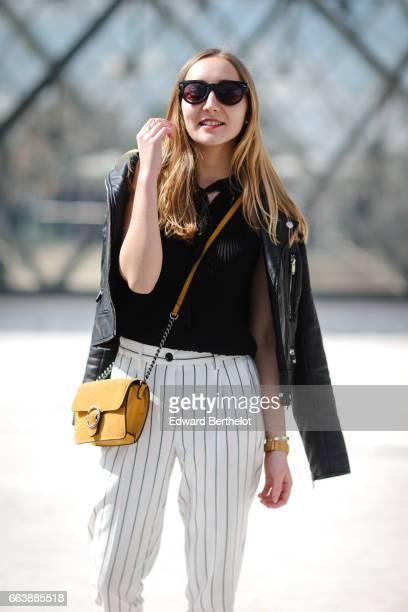 Oceane Grilhe fashion blogger The Blondie World wears Bershka white striped pants a Morgan black top a Zara black leather jacket Pimkie shoes and a...