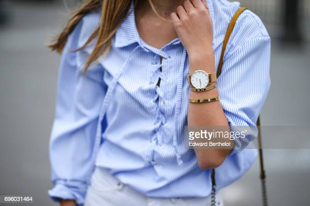 Oceane Grilhe fashion blogger wears New Look blue flower print shoes Cache Cache white denim ripped jeans a Mango yellow bag and a striped blue Lulu...