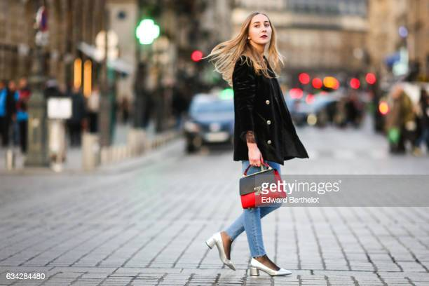 Oceane Grilhe wears Stradivarius silver shoes Calzedonia fishnet tights Stradivarius blue denim jeans pants a Morgan black jacket a black and red...