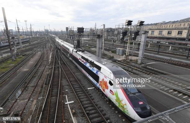 L'Oceane the new TGV high speed train connecting Paris and Bordeaux arrives at Bordeaux's railway station during its inaugurating trip on December 11...