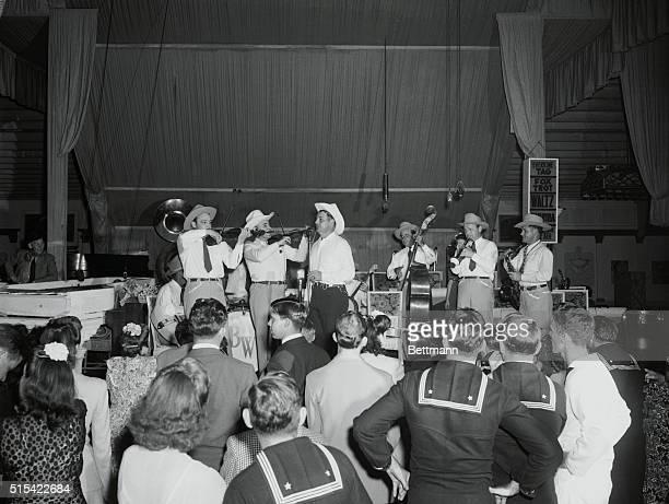 Oceanpark, California: Bob Wills' Cowboy Band playing at the Aragon Ballroom, Oceanpark, California. Left to right, at mike, Joe Ferguson, Bob Wills,...