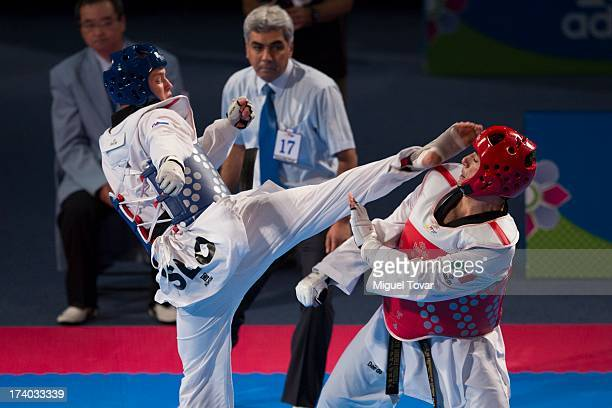 Ocelotzin Sanchez of Mexico competes with Ivan Trajkovic of Slovenia during a men's 87 kg combat of WTF World Taekwondo Championships 2013 at the...