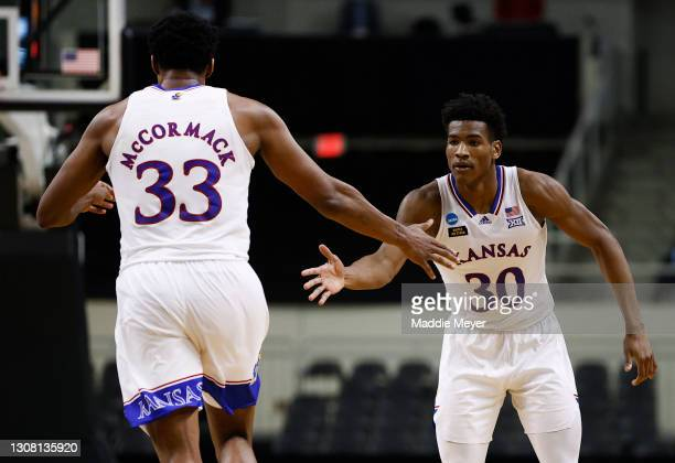 Ochai Agbaji of the Kansas Jayhawks and David McCormack of the Kansas Jayhawks react to a basket during the second half against the Eastern...