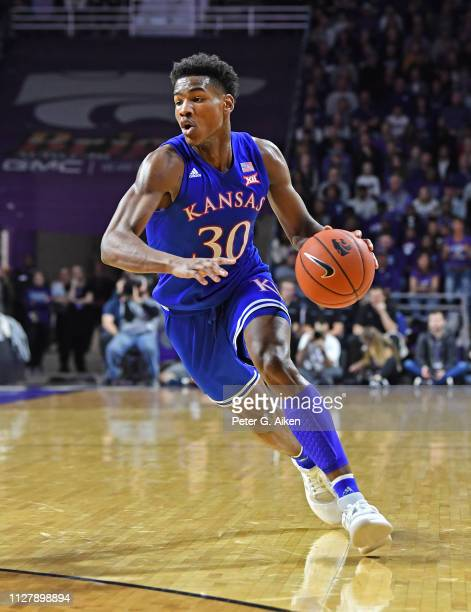February 05: Ochai Agbaji of the Kansas Jayhawks dribbles the ball up court against the Kansas State Wildcats during the first half on February 5,...