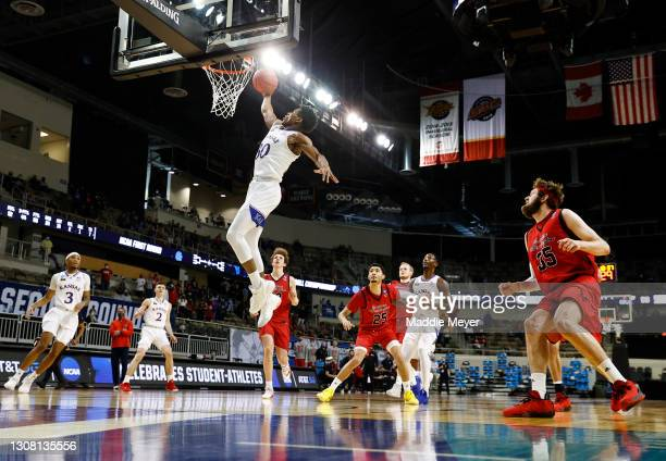 Ochai Agbaji of the Kansas Jayhawks drives the ball to the basket during the second half against the Eastern Washington Eagles in the first round...