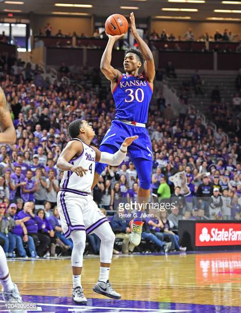 Ochai Agbaji of the Kansas Jayhawks puts up a shot against David Sloan of the Kansas State Wildcats during the first half at Bramlage Coliseum on...