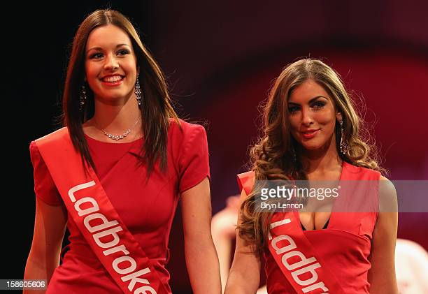Oche girls walk on stage during day seven of the 2013 Ladbrokescom World Darts Championship at Alexandra Palace on December 20 2012 in London England