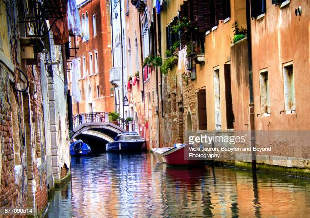 Ochre Tones and Boats Along Canal in Venice, Italy