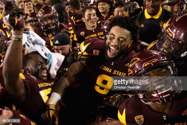 Ochuko Duke and Jay Jay Wilson of the Arizona State Sun Devils celebrate with teammates after defeating the Oregon Ducks in the college football game...