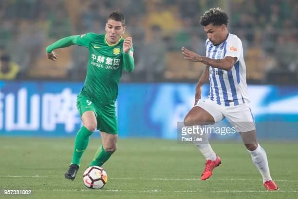 Ocimar de Almeida Junior of Guangzhou RF and Soriano of Beijing Guoan in action during 2018 China Super League match between Beijing Guoan and...