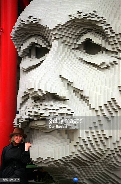 OCLegoEinsteinDB030699––Carlsbad––An adult visitor to Legoland gives scale to a huge sculpture of Albert Einstein crafted from grey plastic Lego...