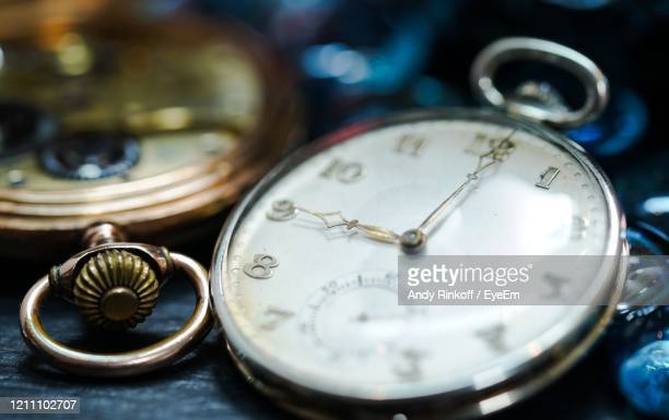9.00 o,clock on pocket watch - andy rinkoff stock pictures, royalty-free photos & images