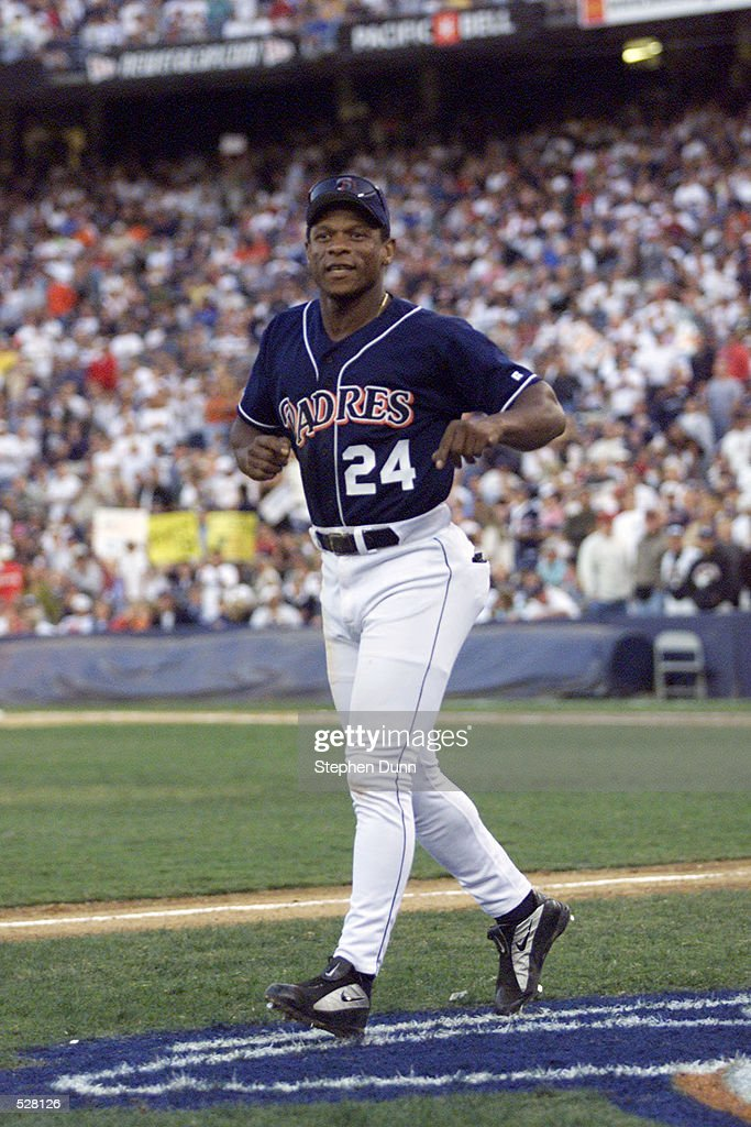 San Diego Padres outfielder Rickey Henderson #24 takes a position as third base coach for Tony Gwynn's final Major League at bat, in their game at Qualcomm Stadium in San Diego, California. The Rockies won 14-5. DIGITAL IMAGE Mandatory Credit: Stephen Dunn/Allsport