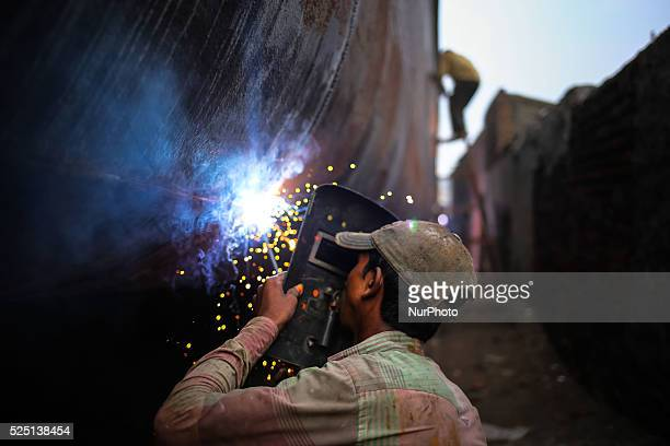 Oct 04 2015 Dhaka Bangladesh Ship building industry in Bangladesh spreading rapidly where workers from all ages work together The working condition...