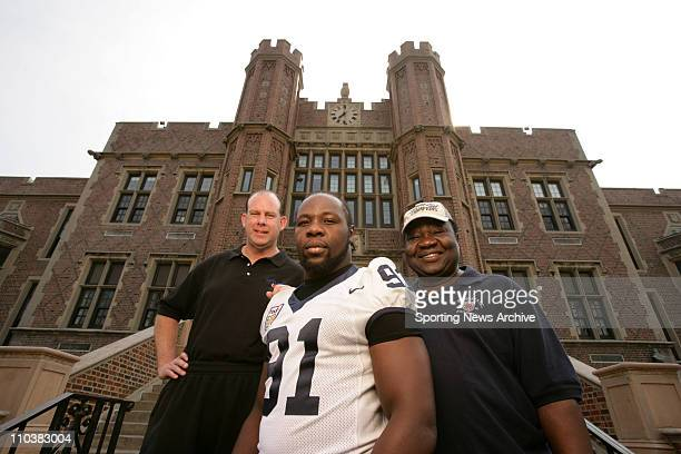 Oct 05 2006 Teaneck NJ USA Penn State TAMBA HALI poses for a portrait at his alma mater Teaneck High School in Teaneck With Hali are his father HENRY...