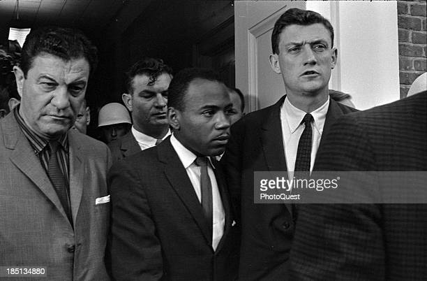 Oct 1 1962 Photograph shows James Meredith and John Doar walking on the campus of the University of Mississippi accompanied by US marshals